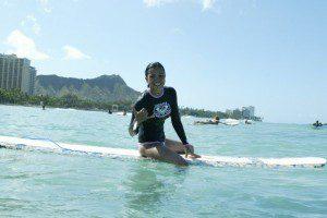 Meg Villanueva surfing